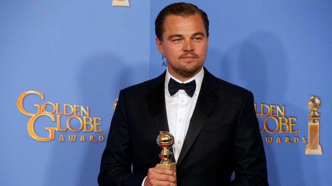 """Leonardo DiCaprio poses with the award for Best Performance by an Actor in a Motion Picture - Drama for his role in """"The Revenant"""" during the 73rd Golden Globe Awards in Beverly Hills, California January 10, 2016(Reuters)"""