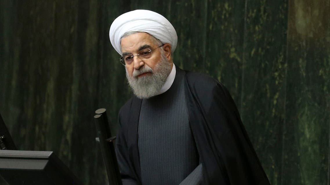 Iranian President Hassan Rouhani addresses lawmakers in an open session of parliament, in Tehran, Iran, Sunday, Jan. 17, 2016. Rouhani said Sunday that the official implementation of the landmark deal reached between Tehran and six world powers has satisfied all parties except radical extremists. (AP Photo/Vahid Salemi)