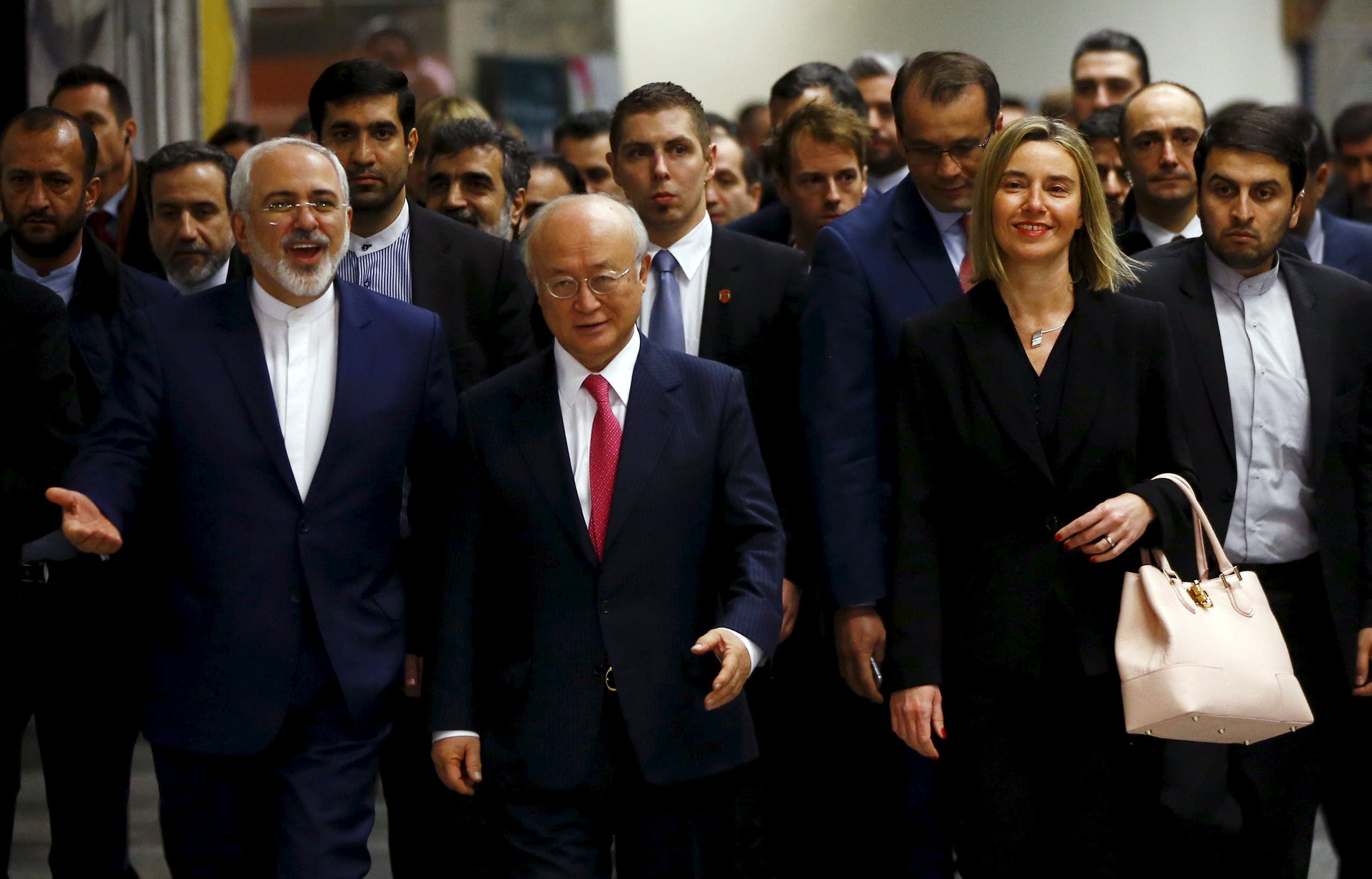 ranian Foreign Minister Javad Zarif, International Atomic Energy Agency (IAEA) Director General Yukiya Amano and the High Representative of the European Union for Foreign Affairs and Security Policy Federica Mogherini (front L-R) arrive at the United Nations building in Vienna, Austria, January 16, 2016. REUTERS