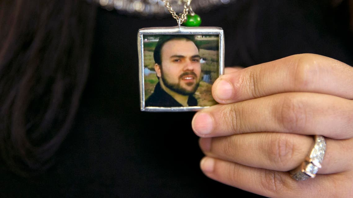 In this June 2, 2015 file photo, Naghmeh Abedini holds a necklace with a photograph of her husband, Saeed Abedini, on Capitol Hill in Washington. AP