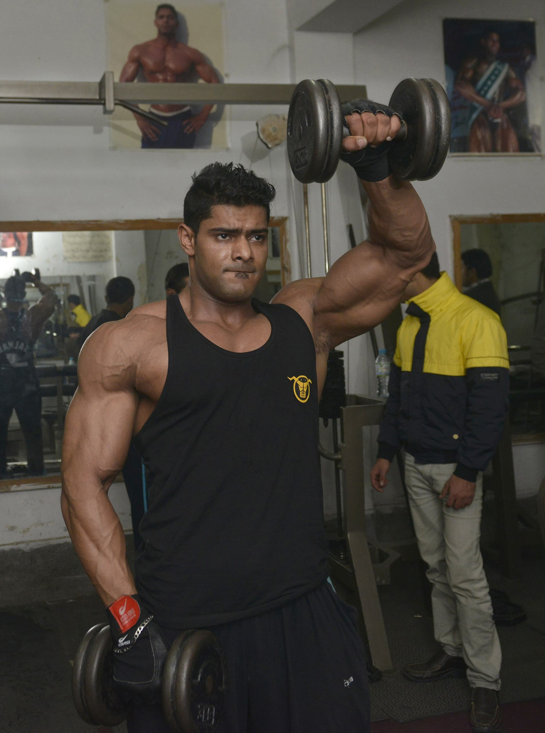 Mr. Musclemania's dilemma: abandon his passion or Pakistan