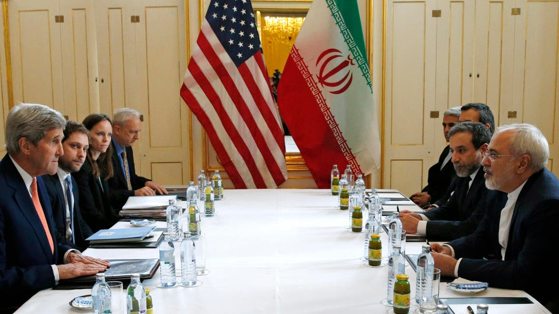 "U.S. Secretary of State John Kerry, left, meets with Iranian Foreign Minister Mohammad Javad Zarif, right, in Vienna, Austria, Saturday, Jan. 16, 2016, on what is expected to be ""implementation day,"" the day the International Atomic Energy Agency (IAEA) verifies that Iran has met all conditions under the nuclear deal. (Kevin Lamarque/Pool Photo via AP)"