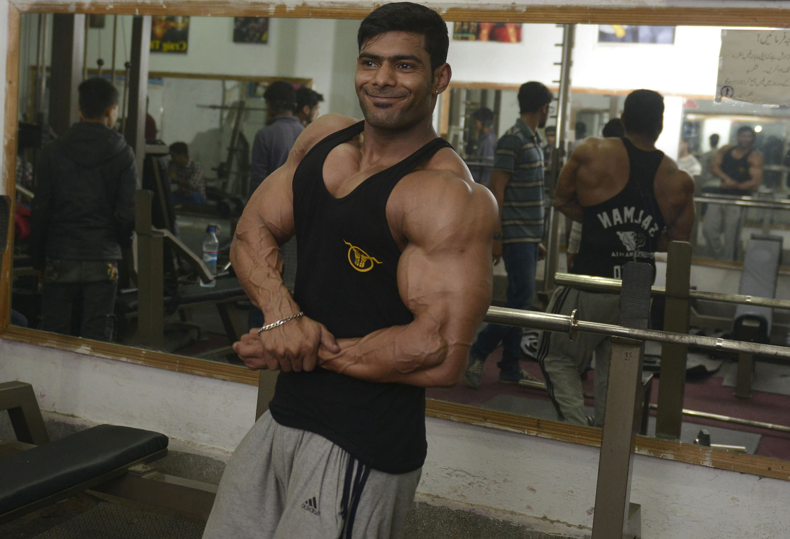 AFP In this photograph taken on January 9, 2016, Pakistani body builder Salman Ahmed poses for a photograph at his gym in Lahore.
