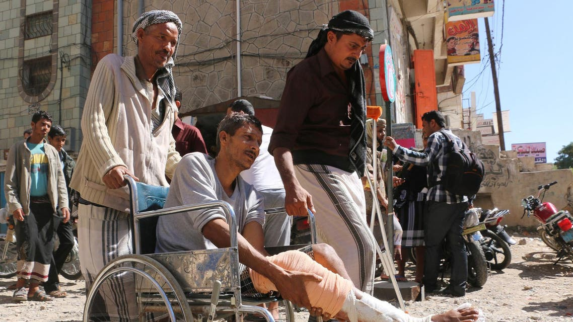 In this Monday, Nov. 23, 2015 photo, wounded people gather during a protest demanding they receive treatment and an end to the blockade imposed by Shiite fighters, known as Houthis, on the city of Taiz, Yemen. In the country's third largest city, residents are battling back against a months-long siege by Shiite rebels, armed by airdrops of weapons by Saudi planes, with hundreds killed and food, water and medicines running short in a potentially pivotal battle in the country's protracted civil war. (AP Photo/Abdulnasser Alseddik)
