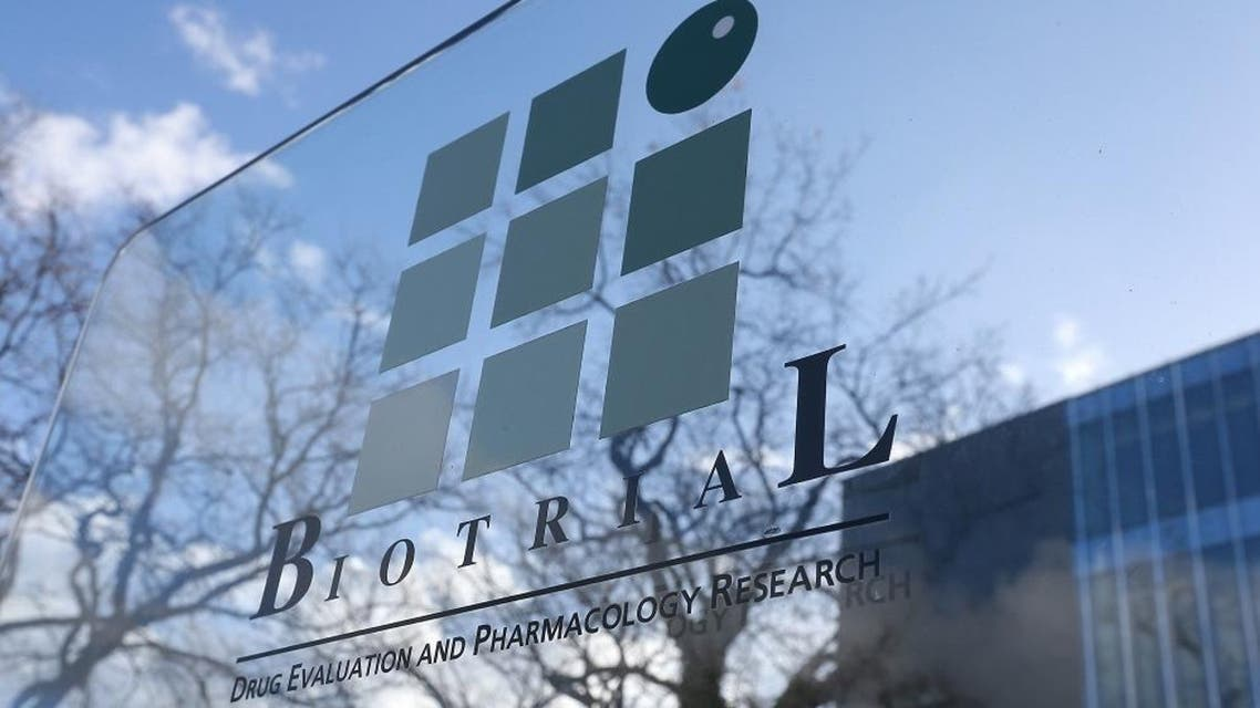 A logo of the Biotrial laboratory is displayed outside its building in Rennes, western France, Friday, Jan. 15, 2016. Officials say six volunteers have fallen ill after participating in a clinical trial in the French city of Rennes and one of them is brain-dead. The French Health Ministry said on Friday that the six were hospitalized after taking a medication that was in the first phase of testing to study safe usage, tolerance and other measures on healthy volunteers. (AP Photo/David Vincent)