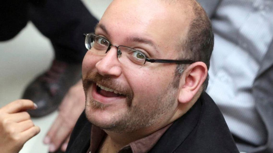 In this photo April 11, 2013 file photo, Jason Rezaian, an Iranian-American correspondent for the Washington Post, smiles as he attends a presidential campaign of President Hassan Rouhani in Tehran, Iran. A source close to Iran's judiciary confirmed to The Associated Press, Saturday, Jan. 16, 2016 that jailed Washington Post bureau chief Jason Rezaian is one of four dual-national prisoners freed by Iran's government and previously announced on Iranian state television without naming those released. (AP Photo/Vahid Salemi, File)