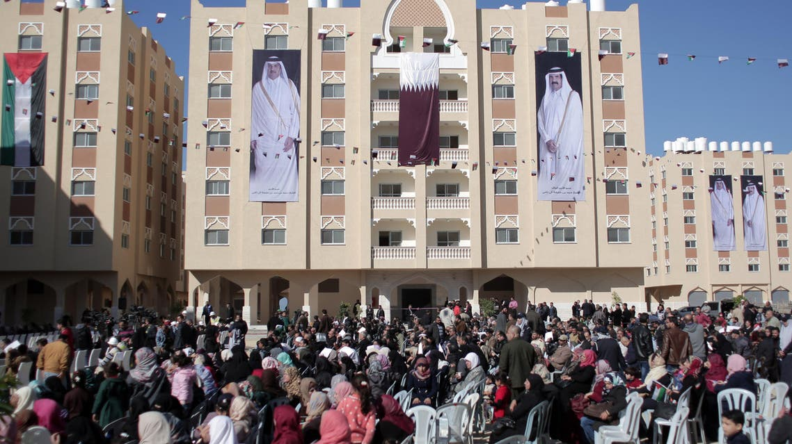 Palestinians gather at the Qatari-funded Hamad City housing complex in Khan Younis, southern Gaza Strip, Saturday, Jan. 16, 2016. AP