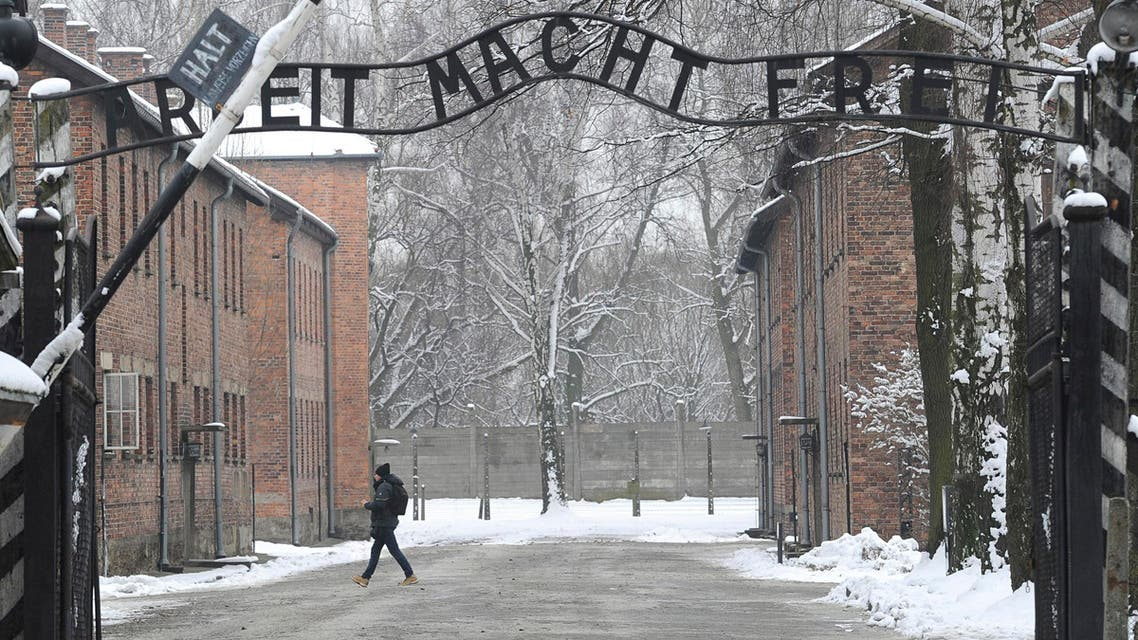 "[Window Title] Enter name of file to save to…  [Content] In this Jan. 26, 2015 file picture a person walks near the entrance to the former Nazi Death Camp complex of Auschwitz with the ""Arbeit Macht Frei"" (Work Sets you Free) (AP) The file name is not valid.  [OK]"