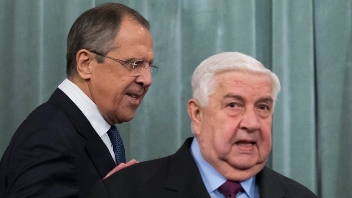 Russian Foreign Minister Sergey Lavrov, left, and Syria's Foreign Minister Walid al-Moallem enter a hall for their news conference following their talks in Moscow, Russia, Friday, Nov. 27, 2015. The presidents of France and Russia agreed Thursday, Nov. 26, 2015 to tighten cooperation in the fight against the Islamic State group, although they remained at odds over their approach toward Syrian President Bashar Assad. (AP Photo/Ivan Sekretarev)