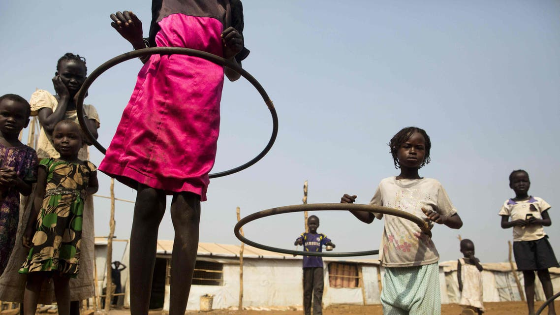 Juba : Children play with hula hoops at the Children Friendly Space, run by UNICEF at the United Nations Missions In South Sudan (UNMISS) Protection of Civillians (PoC) site in Juba, South Sudan, on January 15, 2016. According to UNICEF South Sudan has the highest proportion of out of school children in the world, with more than half (51%) of primary and lower secondary age children do not have access to an education. Even before the 2013 conflict, only one in ten children in South Sudan completed primary school. The country had 1.4 million children out of school. The ensuing two years of violence exacerbat the situation forcing 413,000 more children to drop out of school, leading to the destruction of more than 800 schools. / AFP / Albert Gonzalez Farran