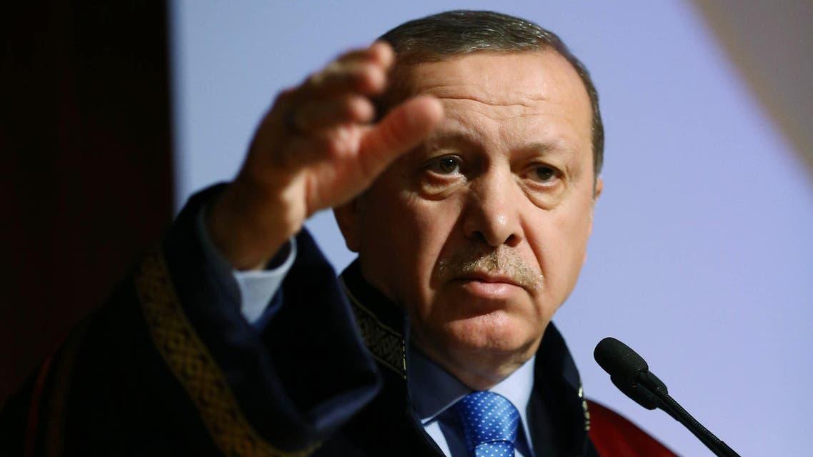 Turkey's President Recep Tayyip Erdogan addresses after he received a honorary doctorate from the Uludag University in Bursa, Turkey, Monday, Dec. 21, 2015. (Kayhan Ozer, Presidential Press Service Pool via AP)