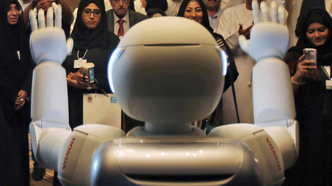 A humanoid robot designed and developed by Honda and named Asimo waves for the audience at the end of the company's presentation during the last day of the Government Summit in Dubai, United Arab Emirates, Wednesday, Feb. 11, 2015. (AP)