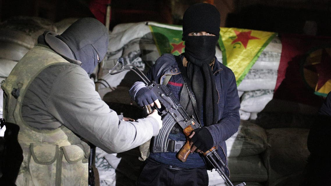 The militants of the Kurdistan Workers' Party, or PKK, stand at a barricade in Sirnak, Turkey, late Wednesday, Dec. 23, 2015. Security forces have killed 183 Kurdish rebels in a week in southeast Turkey, news agencies reported. The government imposed curfews in the mainly Kurdish towns of Cizre, Silopi, Nusaybin and Sur district of Diyarbakir as the security forces battle militants linked to the PKK who have moved their fight for autonomy to some towns and city neighborhoods in southeastern Turkey. (AP Photo/Cagdas Erdogan)