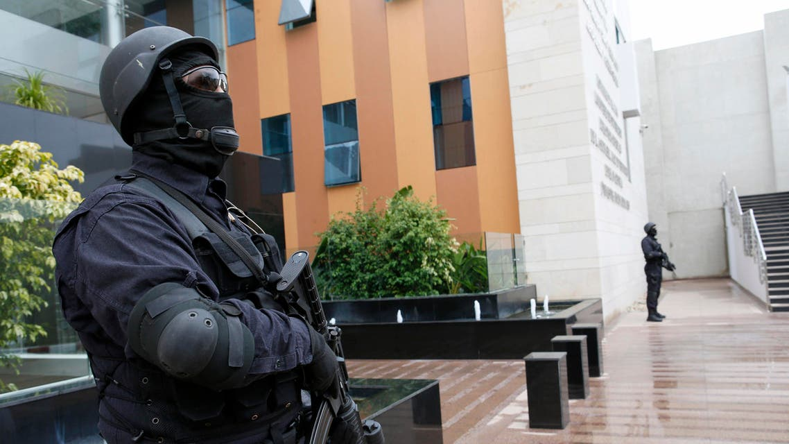 Members of the Moroccan special anti-terror unit guard the headquarters of the Central Bureau of Judicial Investigations in Sale near Rabat, Morocco, Tuesday, Jan. 5, 2016. Khiame says it was his country that put French and Belgian police on the trail of the network behind the Paris attacks that killed 130, and likely spared more lives by pinpointing the location of the man considered the main organizer, holed up outside the French capital. (AP Photo/Abdeljalil Bounhar)