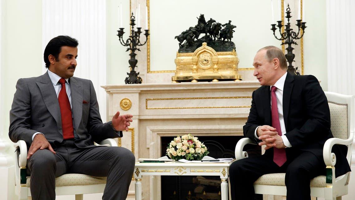 Russian President Vladimir Putin, right, speaks with Qatar's Emir Tamim bin Hamad Al Thani in Moscow's Kremlin, Russia, on Monday, Jan. 18, 2016. (Yuri Kochetkov/Pool photo via AP)