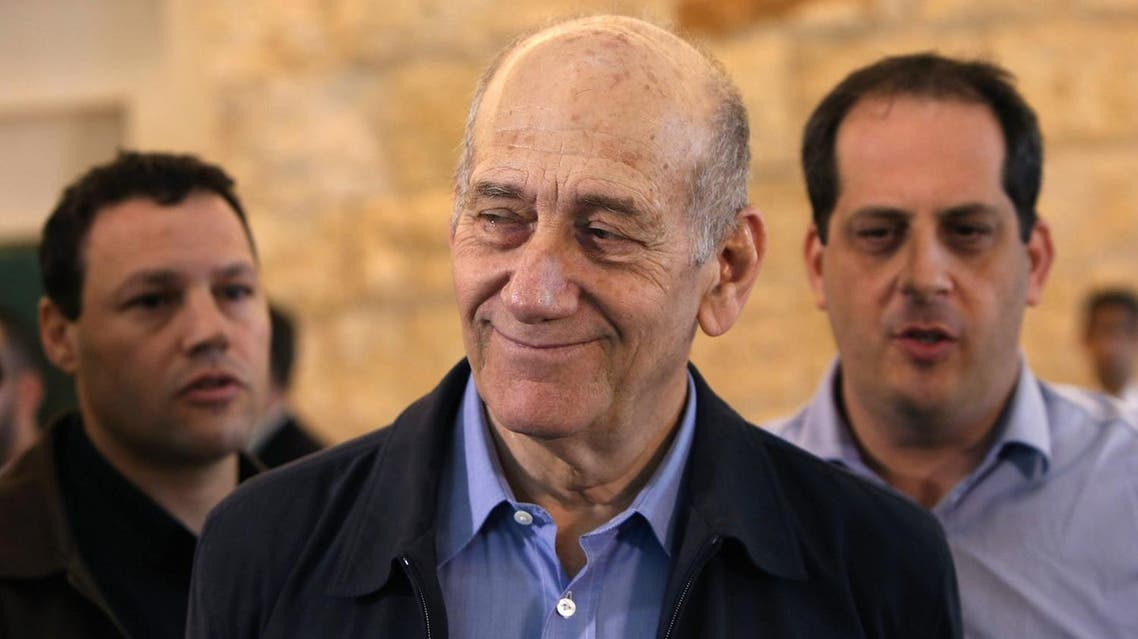Olmert had been sentenced in May 2014 to six years in prison on two separate charges of taking bribes in the early 2000s. (AP)