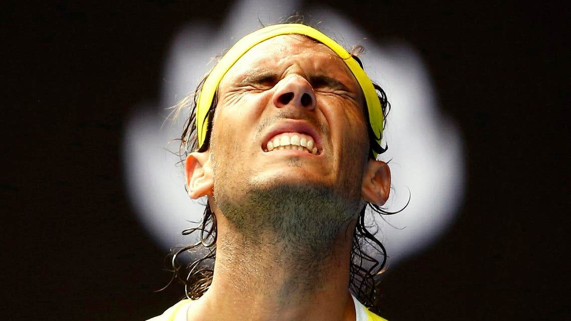 Spain's Nadal reacts during his first round match against Spain's Verdasco at the Australian Open tennis tournament at Melbourne Park, Australia. (Reuters)