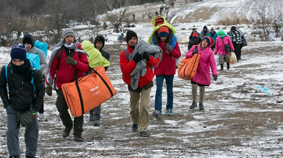 Migrants walk through snow from the Macedonian border into Serbia, near the village of Miratovac, Serbia, Monday, Jan. 18, 2016. Bracing cold temperatures and snow storms hundreds of migrants continue to arrive daily into Serbia in order to register and continue their journey further north towards Western Europe. (AP Photo/Visar Kryeziu)