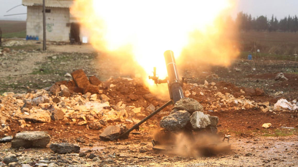 Free Syrian Army fighter fires a shell towards ISIS fighters in the northern Aleppo countryside, Syria, January 18, 2016. (Reuters)