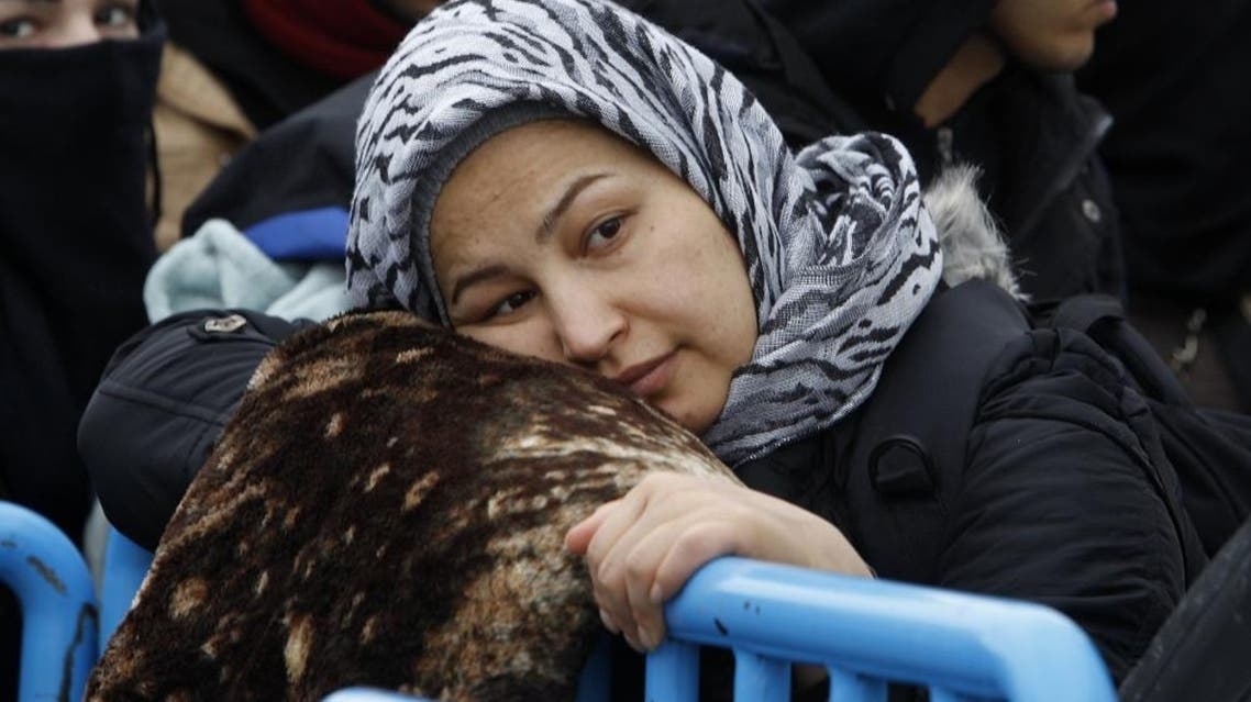 A refugee woman waits to board a train towards Serbia, on her way north to some of the more prosperous European Union countries, from the transit center for refugees near the southern Macedonia's town of Gevgelija, Monday, Jan. 11, 2016. Dozens of Hungary's officers have been sent to Macedonia along with police officers from Serbia and Croatia to help Macedonian colleagues to manage the flow of migrants on its border with Greece. (AP Photo/Boris Grdanoski)