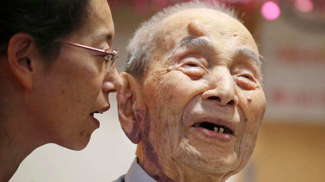 Yasutaro Koide, the 112-year-old living in the central Japanese city of Nagoya, smiles as he talks with his grandchild Aya Kikuchi, 49. (AP)
