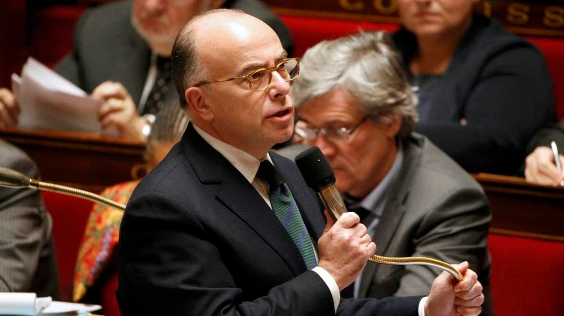 France's Interior Minister Bernard Cazeneuve replies to deputies during the questions to the government session at the National Assembly in Paris, France, January 12, 2016 (Reuters)