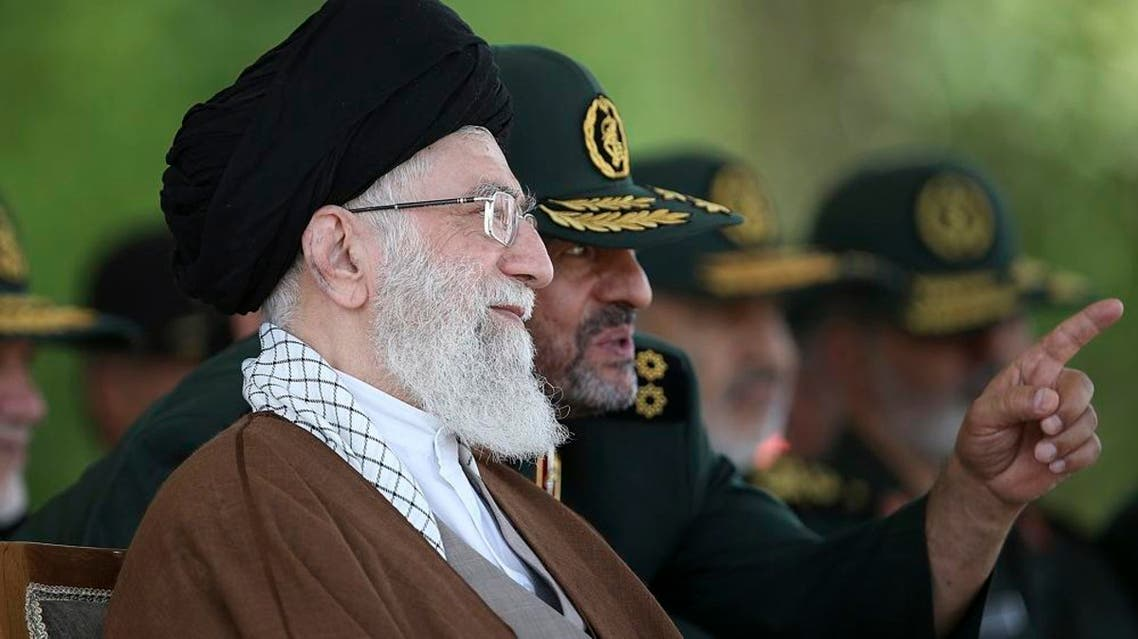 """In this file picture released by the official website of the office of the Iranian supreme leader on Wednesday, May 20, 2015, Supreme Leader Ayatollah Ali Khamenei listens to Revolutionary Guard commander Mohammad Ali Jafari during a graduation ceremony of a group of the guard's officers in Tehran, Iran. In remarks to commanders of the elite Revolutionary Guard Wednesday, Nov. 25, 2015, Khamenei said the United States is using """"money and sex"""" to try to infiltrate the Islamic Republic and warns Iranians not to fall into the """"enemy's trap."""" (Office of the Iranian Supreme Leader via AP, File)"""
