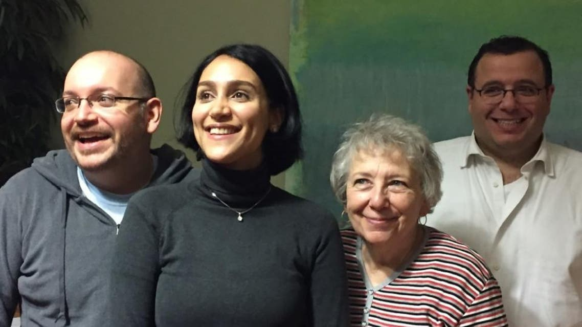 In this January 18, 2016 Washington Post photo former Iranian prisoner Jason Rezaian (L) poses with his wife Yeganeh Salehi (2ndL), mother Mary Rezaian and brother Ali Rezaian (R) (AFP)