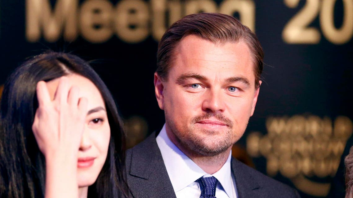 Chinese actress Yao poses with actor DiCaprio after receiving their Crystal Awards during the annual meeting of the WEF in Davos. (Reuters)