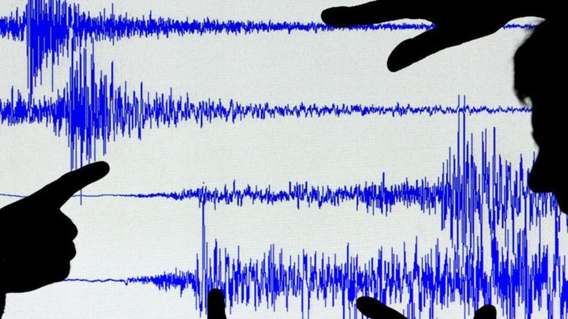 Scientists from the British Geological Survey look at a seismogram readout of Britain's strongest earthquake in twenty years in Edinburgh, Scotland. (Reuters)