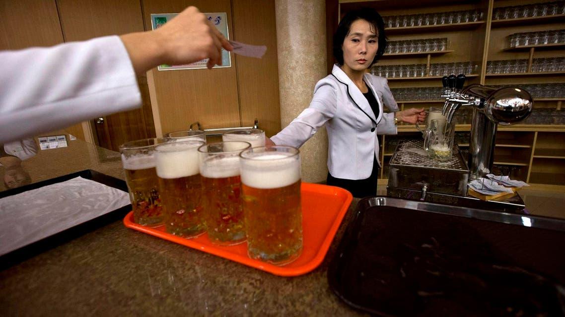 North Korean waitresses prepare to serve beer at the Mansugyo Soft Drink restaurant in Pyongyang, North Korea. (AP)