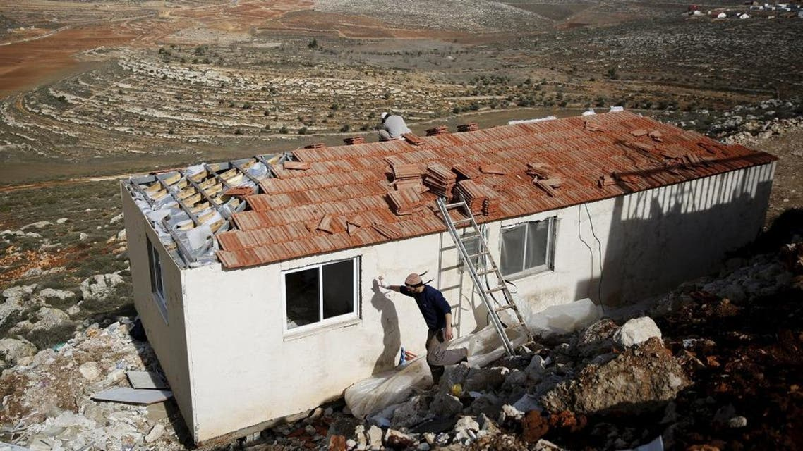 """Jewish settlers work on the construction of a house in the unauthorised Jewish settler outpost of Achiya, south of the West Bank city of Nablus January 5, 2016. Steeped in messianic Jewish mysticism and rebelling against what they see as adulterated modern Zionism, the """"Hilltop Youth,"""" a new generation of ultra-religious settlers whose resentment of the secular Israeli state rivals their hostility toward Arabs, number in the hundreds, by most accounts. But they pose a deep-rooted challenge even for the nationalist government of Prime Minister Benjamin Netanyahu as it struggles to stanch Israeli-Palestinian bloodshed in the absence of peace negotiations. Picture taken January 5, 2016. REUTERS/Ronen Zvulun"""