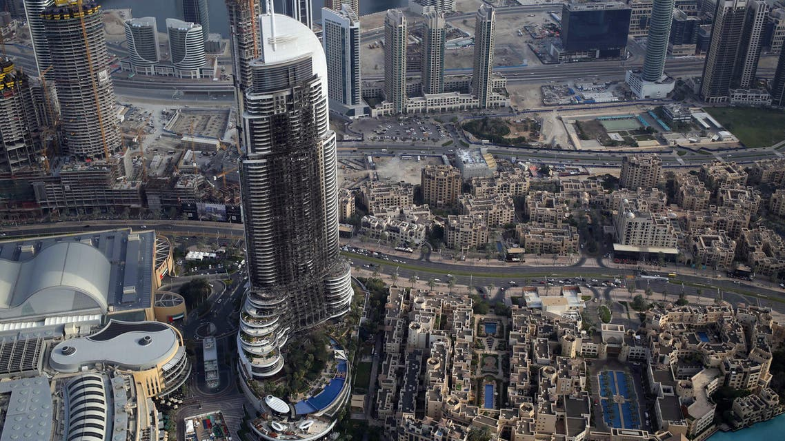 In this Sunday, Jan. 10, 2016 photo, the burned hulk of The Address Downtown is seen in Dubai, United Arab Emirates. AP