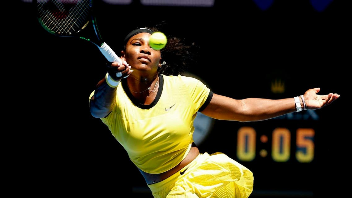 Serena Williams of the United States hits a forehand return to Hsieh Su-Wei of Taiwan during their second round match at the Australian Open tennis championships in Melbourne. (AP)