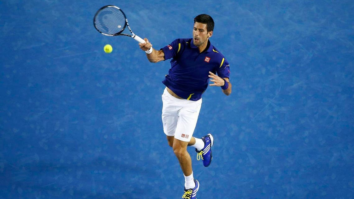 Serbia's Djokovic hits a shot during his second round match against France's Halys at the Australian Open tennis tournament at Melbourne Park. (Reuters)