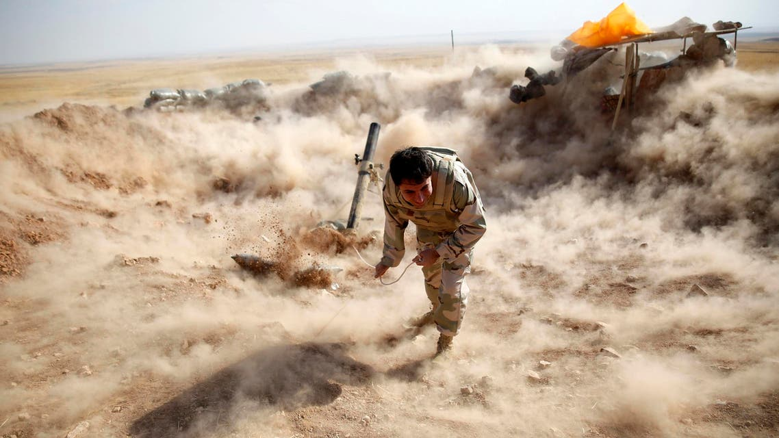 A Kurdish Peshmerga fighter launches mortar shells towards Zummar, controlled by ISIS, near Mosul. (File photo: Reuters)