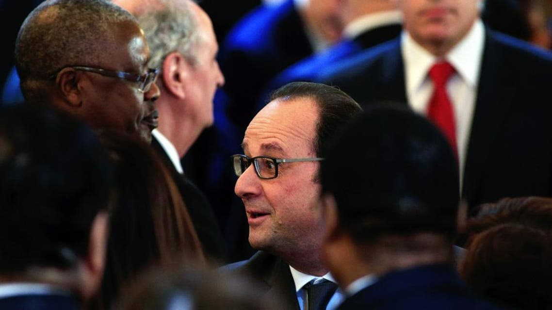 French President Francois Hollande shakes hand with foreign ambassadors during a ceremony to extend New Year wishes at the Elysee Palace, in Paris, Thursday, Jan. 21, 2016. (AP Photo/Thibault Camus/Pool)