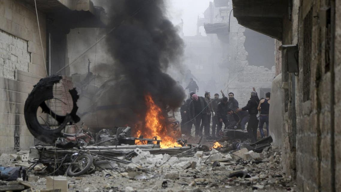 Residents react near a fire amidst debris at a site hit by what activists said were three consecutive air strikes carried out by the Russian air force in the rebel-controlled area of Maaret al-Numan town in Idlib province, Syria. (Reuters)