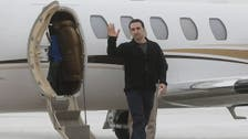 Two Americans held in Iran arrive home after prisoner swap