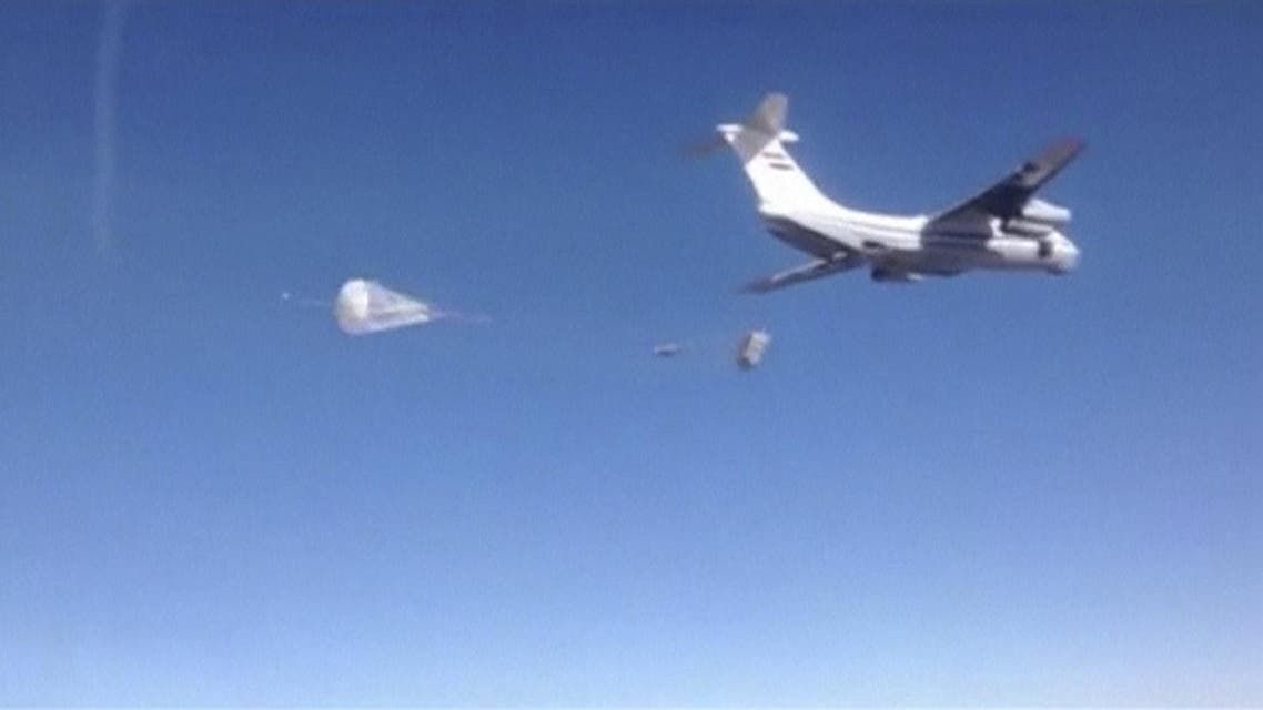 Still image taken from handout video footage shows a Russian air force cargo plane dropping off humanitarian aid in the region around the eastern Syrian city of Deir al-Zor. 9