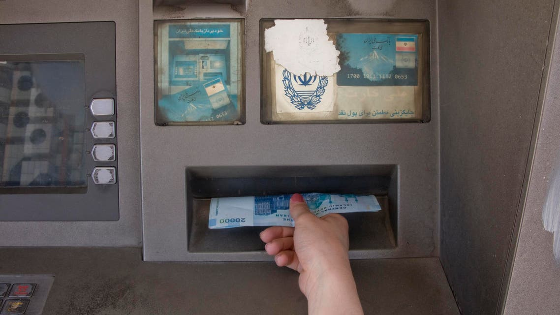 A woman draws money from an ATM machine in Tehran (File photo: Reuters)
