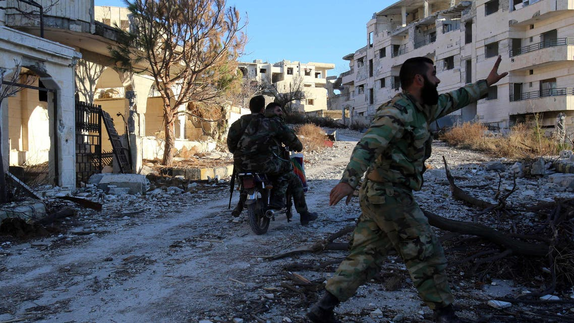 DAM259 - Latakia, Syria : A Syrian army soldier rides a motorcycle in the village of Salma, in the northwestern province of Latakia on January 15, 2016. As Syrian forces battled to recapture the rebel stronghold of Salma last week, they relied not only on Russian air support but also a secret weapon: motorbikes. / AFP / YOUSSEF KARWASHAN