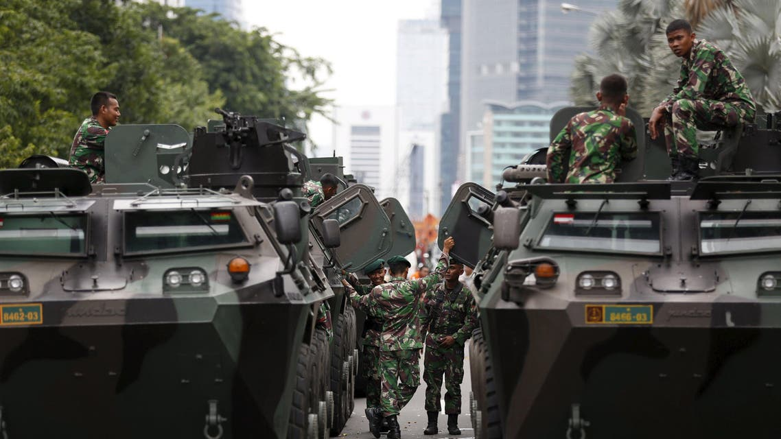 Military armoured personnel carriers are seen near the site of an attack in central Jakarta January 14, 2016. Five militants, including one foreigner, were killed in the gun and bomb assault in central Jakarta, Indonesia's chief security minister said on Thursday. REUTERS/Darren Whiteside