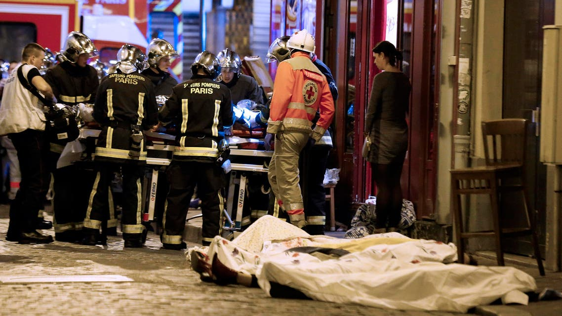 In this Nov. 13, 2015, file photo, rescue workers gather near victims in the 10th district of Paris. (AP)