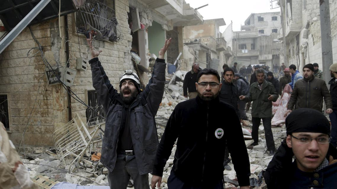 A civil defence member reacts at a site hit by what activists said were three consecutive air strikes carried out by the Russian air force, the last which hit an ambulance, in the rebel-controlled area of Maaret al-Numan town in Idlib province, Syria January 12, 2016. REUTERS/Khalil Ashawi TPX IMAGES OF THE DAY
