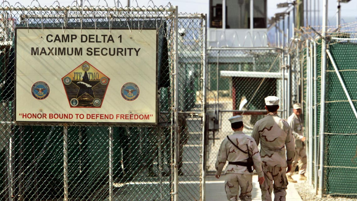 In this file photo made June 27, 2006, reviewed by a U.S. Department of Defense official, U.S. military guards walk within Camp Delta military-run prison, at the Guantanamo Bay U.S. Naval Base, Cuba. (AP)