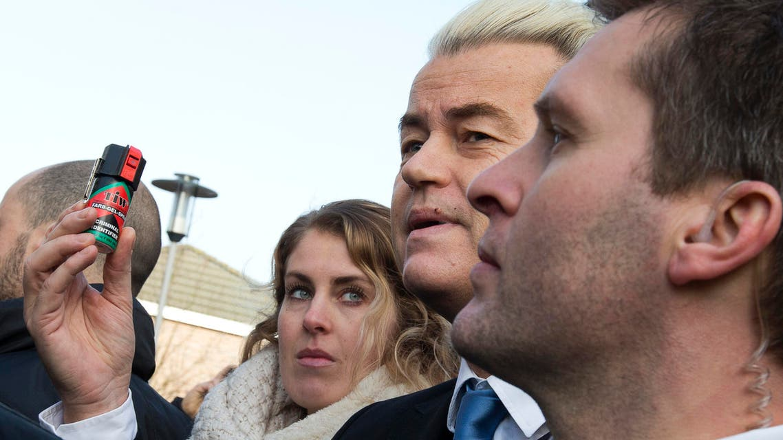 Firebrand Dutch lawmaker Geert Wilders holds a can of pepper spray prior to handing out self-defense sprays to women fearful of being attacked by migrants (AP)