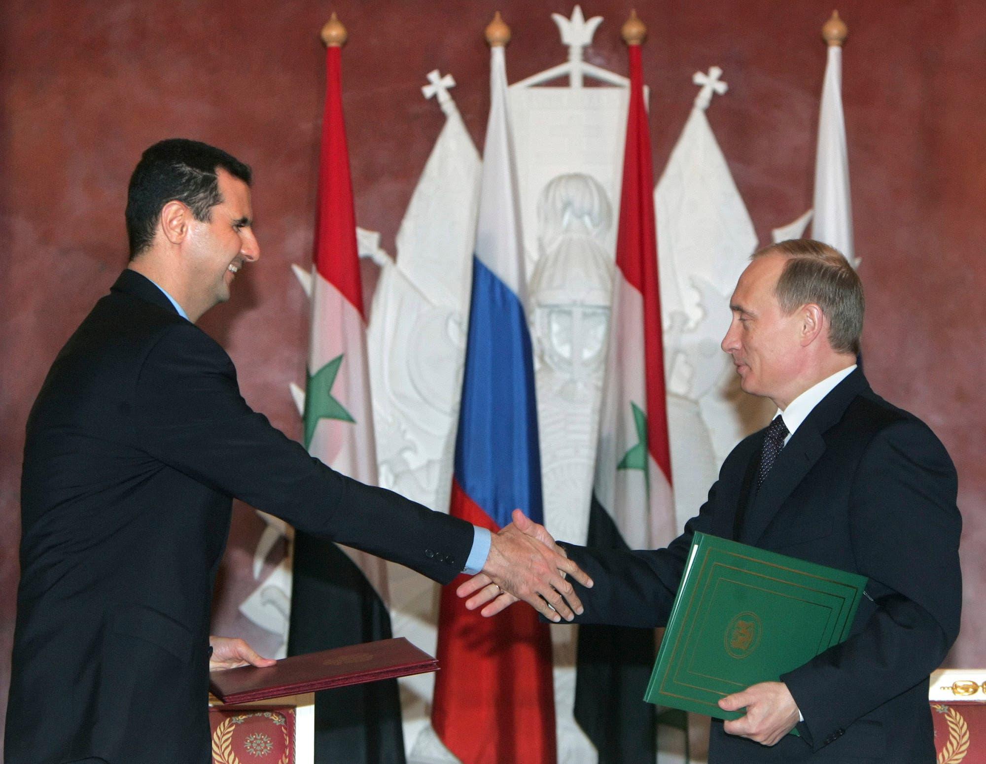 لقاء سابق بين بوتين والأسد
