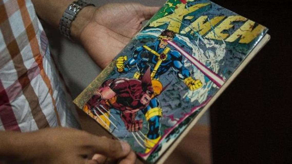 Founder of Comic Republic Jide Martins holds his copy of the best-selling comic book Jim Lee X-Men Vol2, No1, at the Comic Republic office in Lagos (AFP)