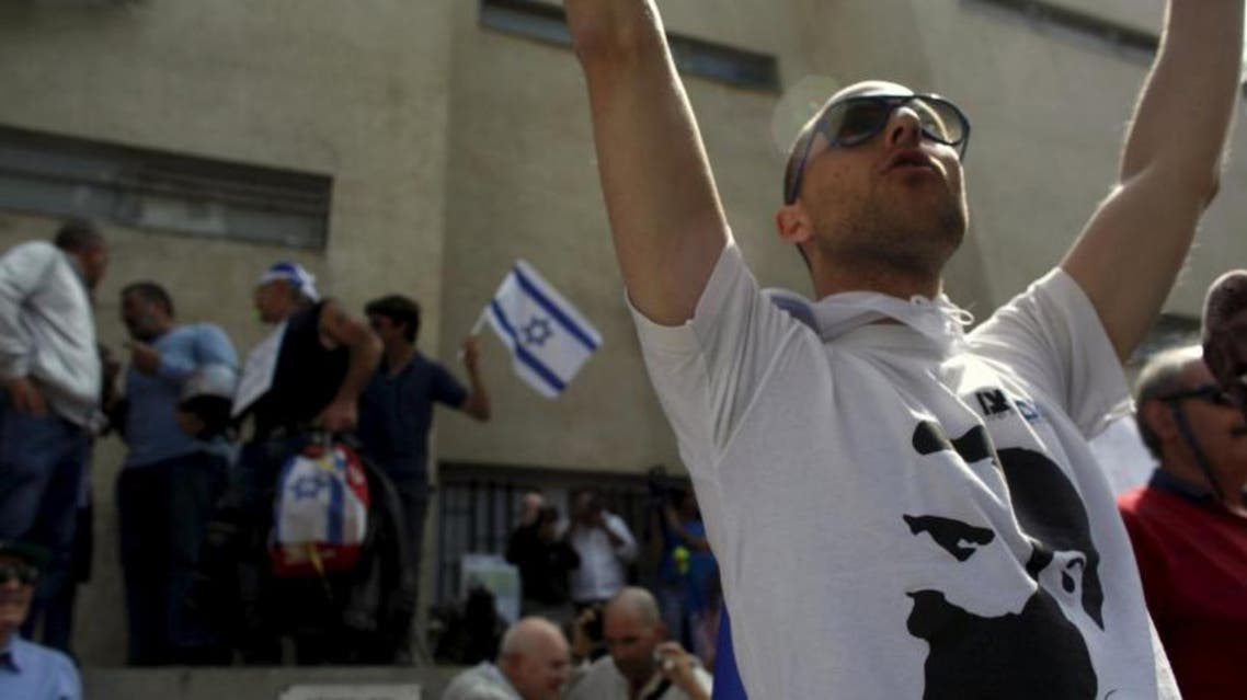 A file picture shows a ring-wing protester demonstrating against a left-wing event in Tel Aviv (File Photo: Reuters)